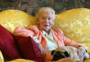 (FILES) A picture taken on January 11, 2002 shows Madame Carven, founder of the Carven fashion house, posing with her dog Naza at her house in Paris. Carven, a driving force in taking France's postwar fashion international, died on June 8, 2015 aged 105, a spokeswoman for her foundation told AFP. AFP PHOTO / JOEL SAGET